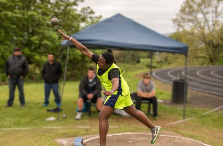 Bryan Mukama shows the shot put for Canyonville Christian Academy