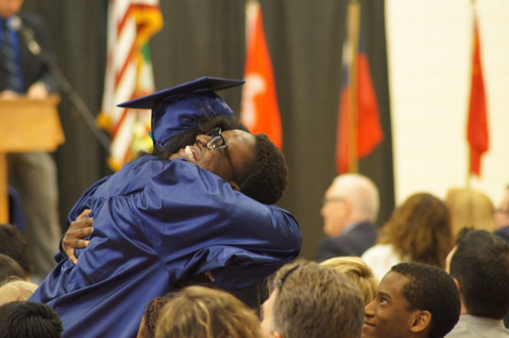 Christian boarding school, students celebrate their graduation with moms, dads, cousins and grandparents
