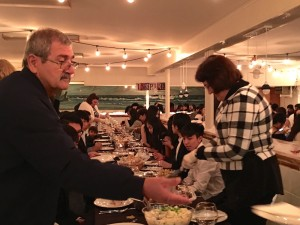 Staff helps with serving, cutting up the turkey, at Christian boarding school, CCA's annual Thanksgiving meal