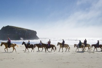 Christian High School, Canyonville Christian Academy, takes students horseback riding on the Pacific Ocean beach.