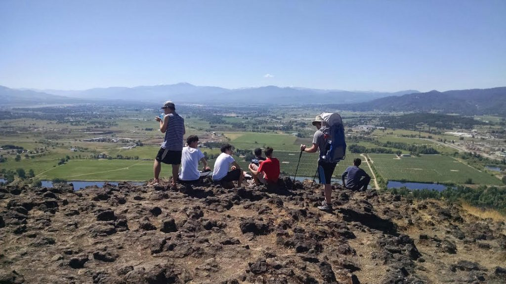 Christian boarding school hobby group enjoys the view from Table Rock, overlooking the Rouge Valley