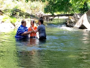 getting baptized in the boarding school's year round creek, that flows through the campus