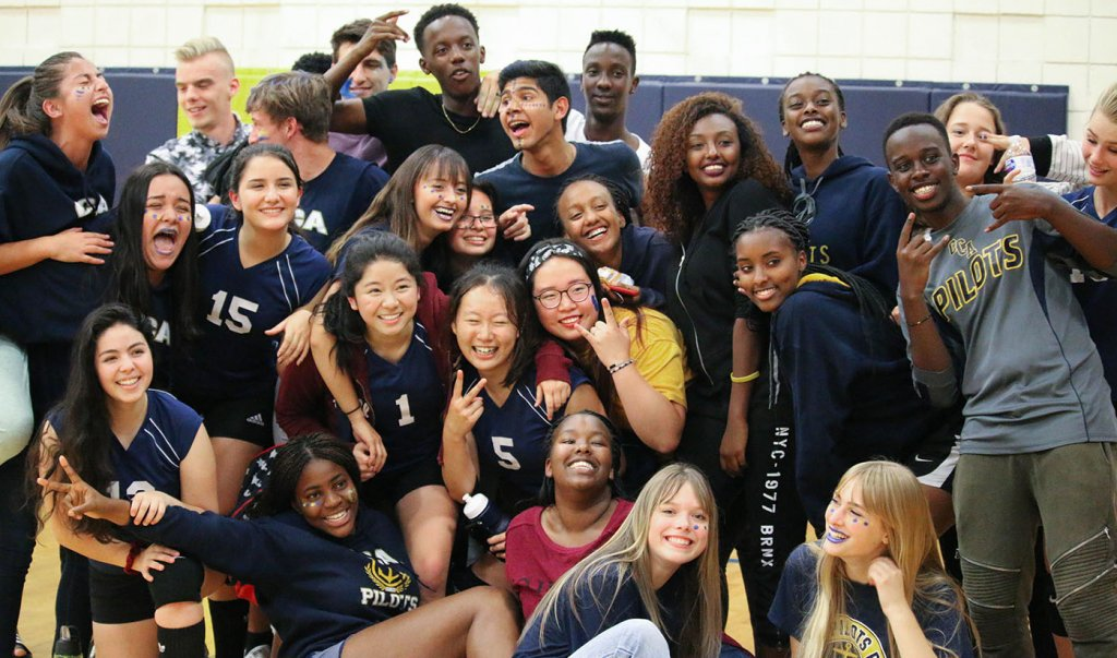 International Students, cheering at Girls' Volleyball game, in Canyonville, at one of the Best Christian Boarding Schools, on the west coast