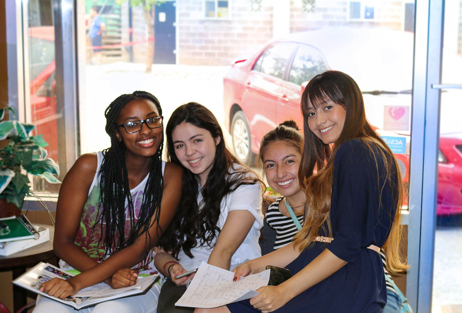 International group of girls sign up for classes at Christian Boarding School