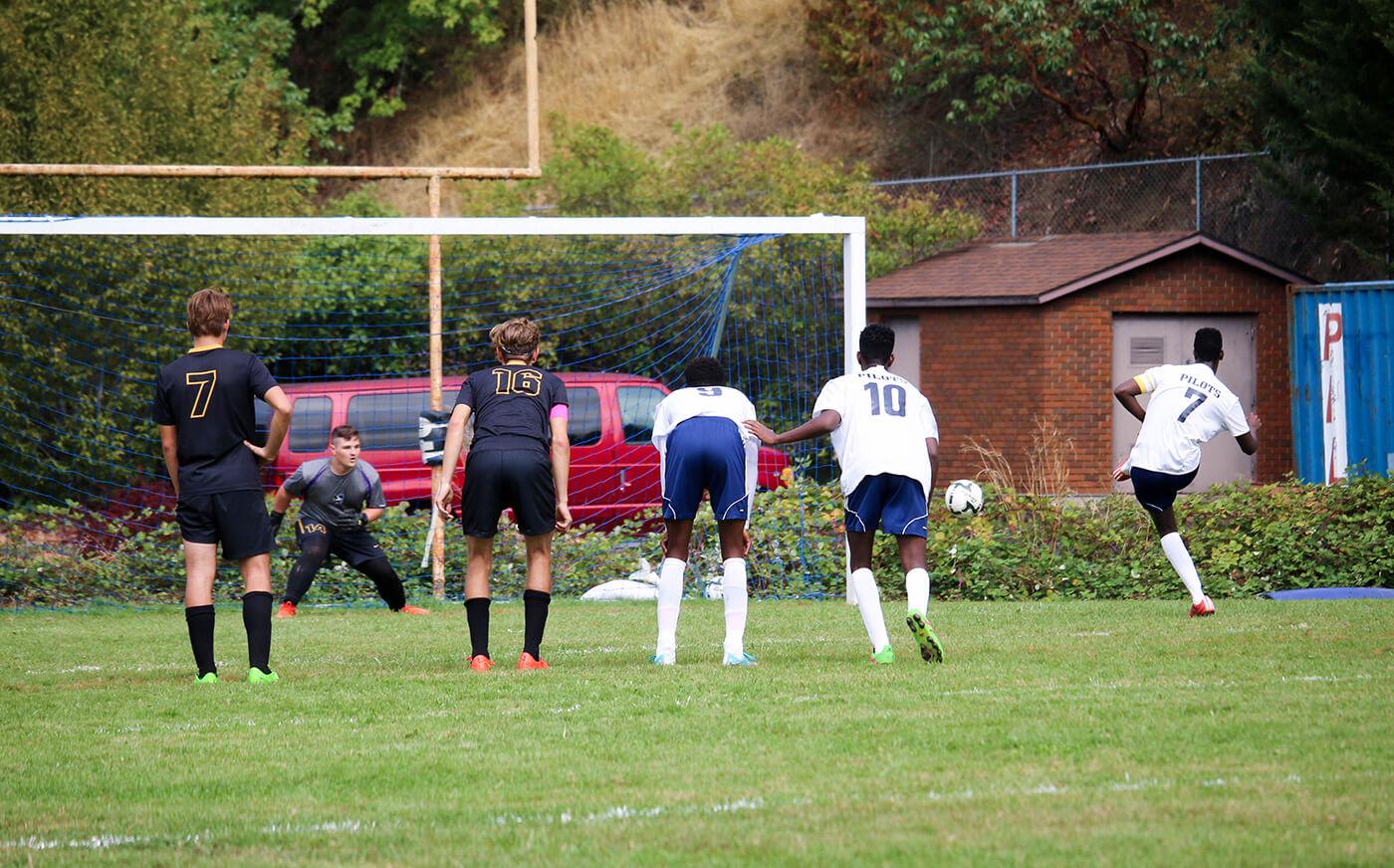 Canyonville christian academy's, boys' soccer team, kicks a penalty kick, to score a goal