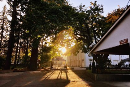 christian boarding school, late afternoon sunshine, main campus area