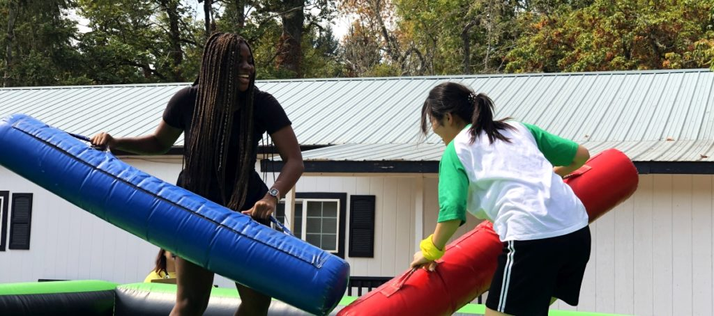 Private academy students, jousting, during Canyonville Academy's Fun Day Event